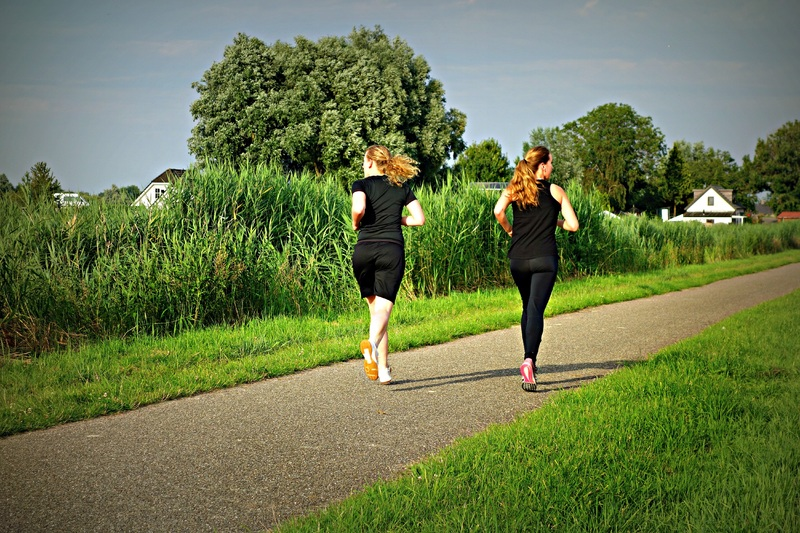 Woman Jogging In A Park Athelio Exercise Hacks